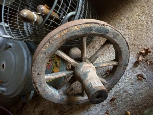 Old cartwheel - very heavy. Made of wood and metal