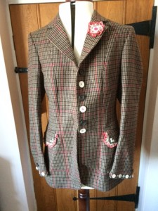 Attractive tweed jacket with red check. Decorated with buttons and pretty vintage lace